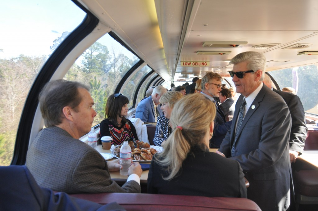 Mississippi Gov. Phil Bryant (right) talks to Gulfport Mayor Billy Hewes (left) and FRA Administrator Sara Feinberg (right of Hewes) on the Gulf Coast Inspection Train on February 18, 2016.
