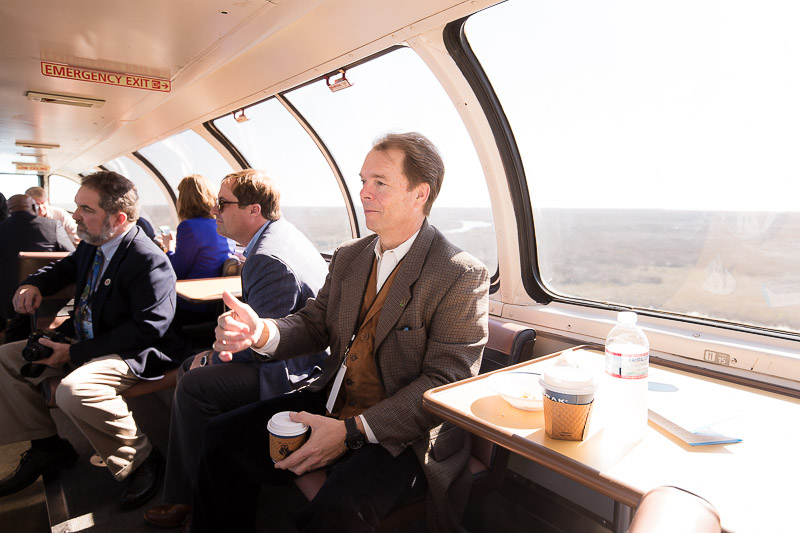 Gulfport Mayor Billy Hewes chatting on the ride into Gulfport on February 18, 2016. Photo courtesy of Charles Gomez / Amtrak
