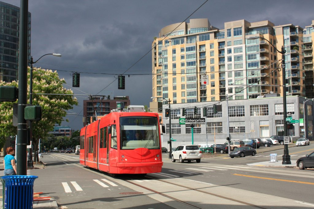 A downtown-bound street car glides through South Lake Union, the neighborhood that Amazon will soon call home.