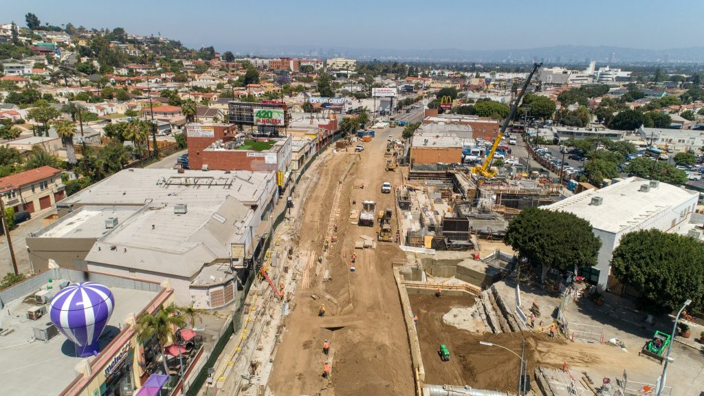 Bird's eye view of construction on a wide road in Los Angeles.