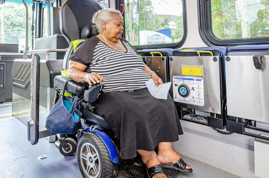 Person in a wheelchair inside a bus.