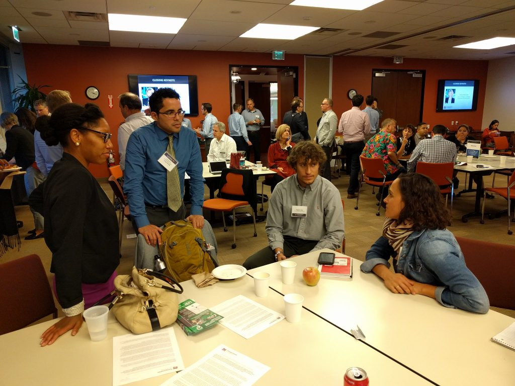 people talking at a table during smart cities meeting