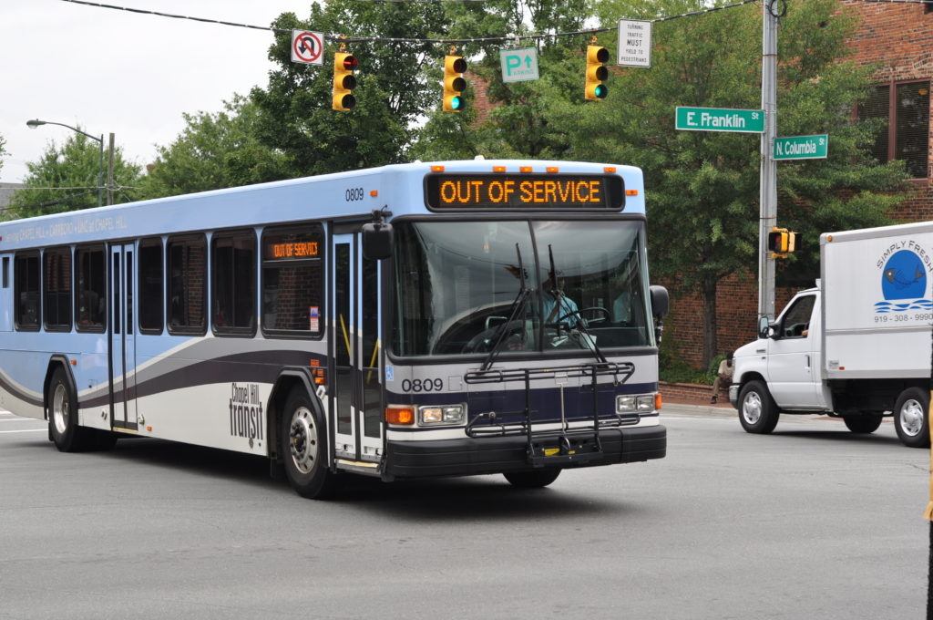 an out of service bus drives through an intersection