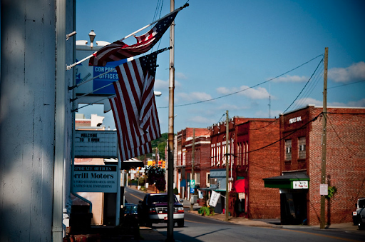 Erwin's downtown with multiple historic buildings and American flags